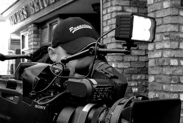 web design screenshot - man with camera